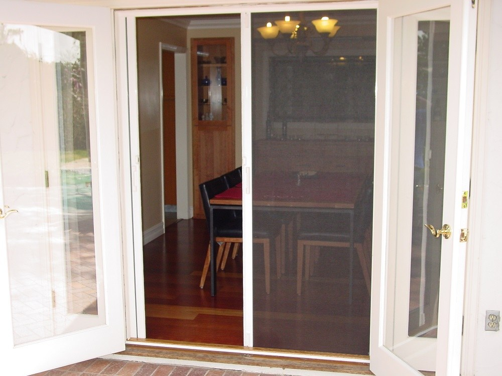 Enjoy dining on your patio install screen doors and windows